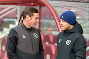 Heart of Midlothian coach Andy Kirk (left) chats with Steven Naismith (#14) of Heart of Midlothian FC before the Ladbrokes Scottish Premiership match between Heart of Midlothian FC and St Johnstone FC at Tynecastle Park, Edinburgh, Scotland on 14 December 2019.