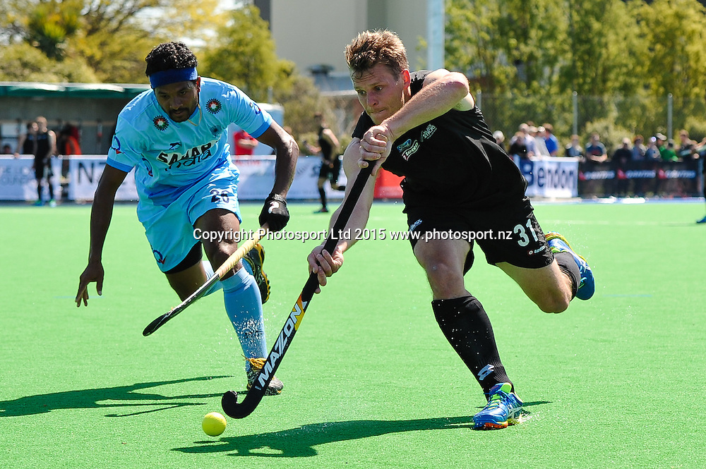 Steve EDWARDS of the Black Sticks is tackled by Birendra Lakra of India during the Mens Hockey International, 2015 South Island Tour game between the New Zealand Black Sticks V India, at Marist Park, Christchurch, on the 11th October 2015. Copyright Photo: John Davidson / www.photosport.nz