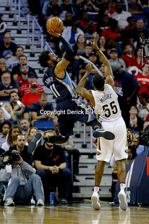 Mar 21, 2017; New Orleans, LA, USA; Memphis Grizzlies guard Mike Conley (11) shoots over New Orleans Pelicans guard E'Twaun Moore (55) during the second half of a game at the Smoothie King Center. The Pelicans defeated the Grizzlies 95-82. Mandatory Credit: Derick E. Hingle-USA TODAY Sports