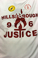 Photo: Paul Greenwood.<br /> Liverpool v Arsenal. The FA Cup. 06/01/2007. A Liverpool fans wears his Hillsborough Protest T Shirt