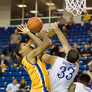 Delaware Forward Carl Baptiste (33) fouls Hofstra Forward Jordan Allen (0) in the second half of a NCAA regular season Colonial Athletic Association conference game between Delaware and Hofstra Wednesday, JAN 8, 2014 at The Bob Carpenter Sports Convocation Center in Newark Delaware.