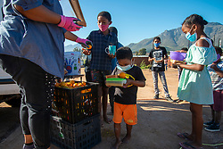 A volunteer food drive in Mountain View, an informal settlement in Jamestown, located in the Cape Winelands District, on Saturday, May 29, 2020. It's estimated that most, if not all, of the households here had no income, due to unemployement during lockdown. Cape Winelands is one of the districts in the Western Cape that has been designated a hotspot area, in terms of people testing positive for COVID-19. When South Africa moves down to Stage 3 of the nationwide lockdown on June 1st, hotspots areas will remain under stricter regulation and surveillance, per the latest government announcements. PHOTO: EVA-LOTTA JANSSON