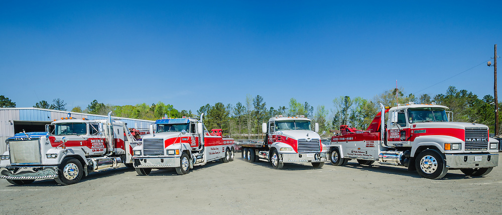 Mack Trucks are pictured at Mike Adams Towing and Air Cushion Recovery, March 22, 2016, in Macon, Georgia. Adams started his business with a 1993 with a 1989 Mack Super-Liner. Today, he owns 27 towing and recovery trucks, nearly a third of which are Macks. His newest acquisition (not pictured) is a 2016 Mack Granite with a 50-ton Century rotator. (Photo by Carmen K. Sisson/Cloudybright)