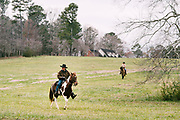 GALLANT, AL – DECEMBER 12, 2017: Judge Roy Moore (center), the Republican candidate, approaches a voting station at the Gallant Fire Department on horseback along with his wife, Kayla.  CREDIT: Bob Miller for The New York Times