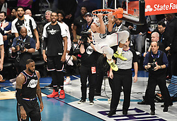 February 17, 2019 - Charlotte, NC, USA - Team Giannis' Stephen Curry, of the Golden State Warriors, goes up for a reverse two-handed dunk, as Team LeBron's LeBron James, of the Los Angeles Lakers, looks on during the 2019 NBA All-Star 2019 game at Spectrum Center in Charlotte, N.C. on Sunday, February 17, 2019. (Credit Image: © David T. Foster Iii/Charlotte Observer/TNS via ZUMA Wire)