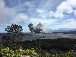 Hanout photo of KÄ«lauea Volcano — Eruption at Halema`uma`u Crater. View of a rising ash plume from Halema'uma'u, a crater at the summit of KÄ«lauea, late yesterday (May 24, 2018), as seen from the caldera rim near Volcano House. USGS scientists are stationed at this vantage point to track the ongoing summit explosions. Photo by USGS via ABACAPRESS.COM