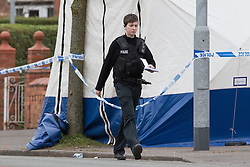 © Licensed to London News Pictures . 01/03/2013 . Manchester , UK . Police on Wilbraham Road , Chorlton , Manchester today (1st March 2013) . Police report they are investigating following the discovery of a body this morning (1st March) . Photo credit : Joel Goodman/LNP