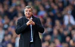LONDON, ENGLAND - Sunday, April 6, 2014: West Ham United's manager Sam Allardyce looks dejected as his side lose 2-1 to Liverpool during the Premiership match at Upton Park. (Pic by David Rawcliffe/Propaganda)
