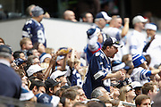 A Dallas Cowboys fan celebrates after a Cowboys touchdown against the New Orleans Saints at Cowboys Stadium in Arlington, Texas, on December 23, 2012.  (Stan Olszewski/The Dallas Morning News)
