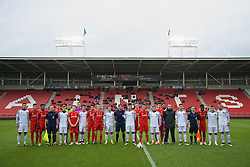 LIVERPOOL, ENGLAND - Tuesday, December 9, 2014: Liverpool and FC Basel players stand together before the UEFA Youth League Group B match at Langtree Park. (Pic by David Rawcliffe/Propaganda)