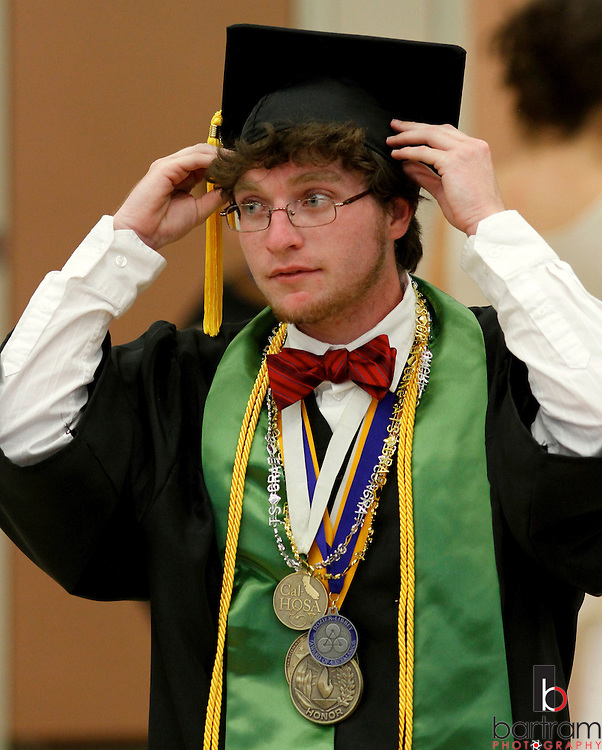 Ethan Mahoney prepares for graduation at Dozier-Libbey Medical High School on Friday, June 8, 2012. Mahoney was the recipient of the Dozier-Libbey award of excellence along with state and national awards from HOSA. (Photo by Kevin Bartram)