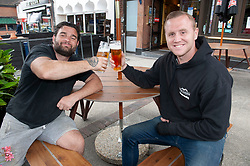 ©Licensed to London News Pictures 04/07/2020     <br /> Petts Wood, UK. Jake Tevlin (R) and Wes Chambers (L) from Dream Gardens finish work early and head to The Sovereign of the Seas pub in Petts Wood, South East London. England's pubs pour their first pints today after three months closed due to coronavirus Lockdown. Photo credit: Grant Falvey/LNP