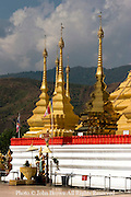 Traditional gold stupas are part of the the beautiful Shwe Dagon Pagoda Buddhist temple in Tachilek, Burma (Myanmar).