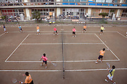 school children playing tennis