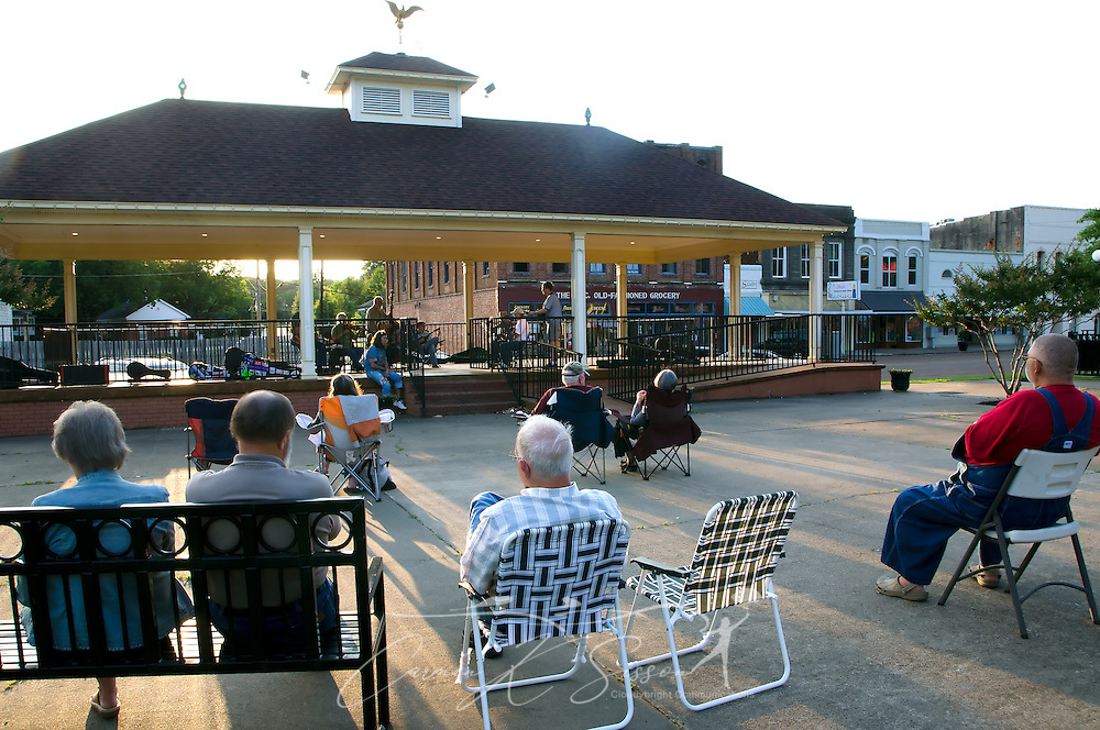 Fans listen as bluegrass musicians perform on a Saturday evening in Railroad Park in Water Valley, Mississippi. (Photo by Carmen K. Sisson/Cloudybright)