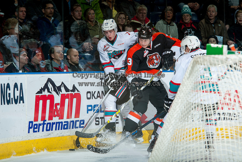KELOWNA, CANADA - JANUARY 23: Nick Heid #3 of Medicine Hat Tigers checks Kole Lind #16 of Kelowna Rockets behind the net on January 23, 2016 at Prospera Place in Kelowna, British Columbia, Canada.  (Photo by Marissa Baecker/Shoot the Breeze)  *** Local Caption ***Kole Lind; Nick Heid;