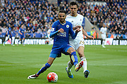 Leicester City midfielder Riyad Mahrez  shields the ball from Swansea City midfielder Jack Cork during the Barclays Premier League match between Leicester City and Swansea City at the King Power Stadium, Leicester, England on 24 April 2016. Photo by Alan Franklin.