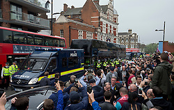 © Licensed to London News Pictures. 10/05/2016. LONDON, UK. The Manchester United team bus arrives under heavy police escort before their game at Boleyn Ground against West Ham United. Photo credit: LNP