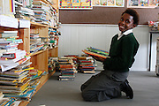 Learners place books on the shelves of the new library in a temporary portacabin. Despite receiving a court order to provide plans for a permanent school in August 2010, the department of Basic Education had failed to do so as of March 2012. The Legal Resources Centre continues to represent the school as they push for adequate facilities...Amasango Career School. Amasango is a primary school for children with special needs. It is housed in disued railway buildings on a gravel plot on the outskirts of Grahamstown...©Zute & Demelza Lightfoot/ Legal Resources Centre