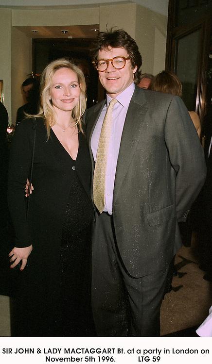 SIR JOHN & LADY MACTAGGART Bt. at a party in London on November 5th 1996.                          LTG 59