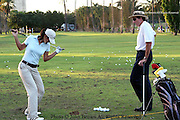 Fifteen year old Michelle Wie receives instruction from her swing coach, David Ledbetter, prior to the PGA 2005 Sony Open In Hawaii. The event was held at The Waialae Country Club in Honolulu.