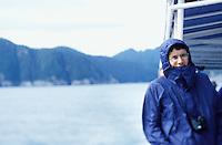 Portrait of a man on a tour boat off the Kenai Penninsula, Alaska, USA.