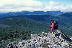 A hiker makes his way among the rocks on Mt. Abraham, near the Appalachian Trail.  Kingfield, ME.
