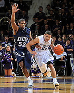 MANHATTAN, KS - DECEMBER 08: Guard Denis Clemente #21 of the Kansas State Wildcats drives the ball up court against pressure from guard Terrell Holloway #52 of the Xavier Musketeers in the second half on December 8, 2009 at Bramlage Coliseum in Manhattan, Kansas.  (Photo by Peter G. Aiken/Getty Images)