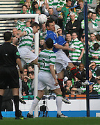 Stephen McManus heads clear from Lee McCulloch during the League Cup final between Rangers and Celtic at Hampden Park -<br /> David Young