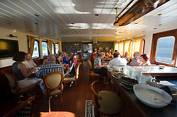 Tourists from Germany enjoy a Boat and Bike tour through Flanders. Tour members eat breakfast on their boat the MS Magnifique, in Bruges, Belgium on Sunday, July 11, 2010. (Photo © Jock Fistick)