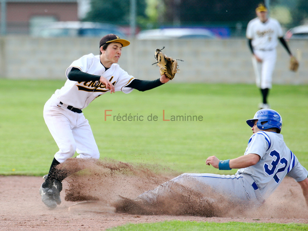 May 8, 2010; Wepion, Belgium. Belgian Baseball Championship (1BB) : match between the Namur Angels (white) and the Hoboken Pioneers (grey/blue). Florentin Goyens (28) of the Namur Angels attempts to make an out at 2nd base against Randy Giorgadis (32) of the Pioneers. Pioneers defeated the Angels 4-1