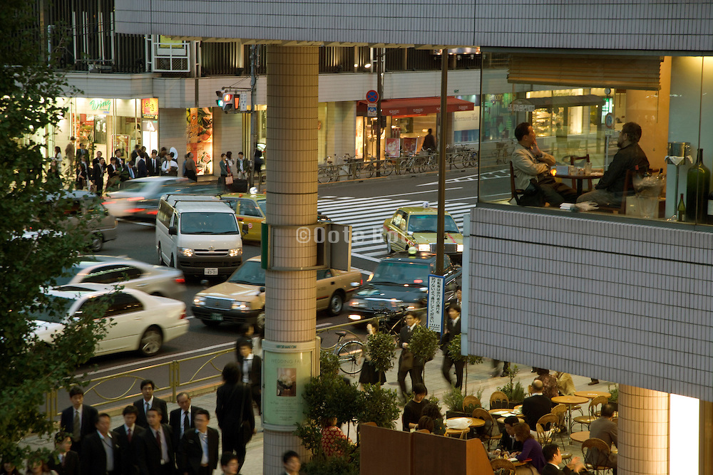 businesspeople going home commuter traffic and bar meeting up near Shinagawa station Tokyo Japan