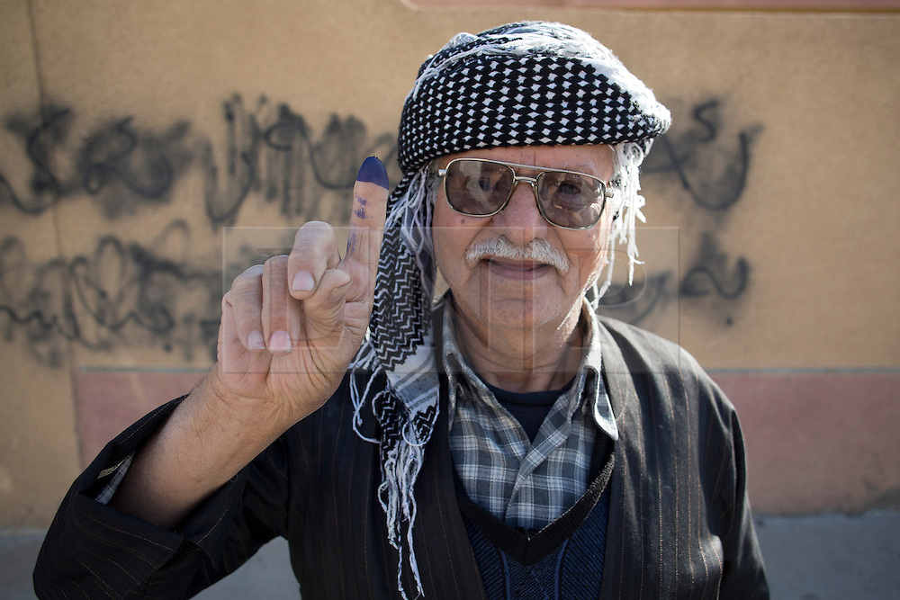© Licensed to London News Pictures. 30/04/2014. Sulaimaniya, Iraq. An elderly Iraqi-Kurdish man holds up his finger to show the ink mark on his finger that denotes he has voted in the 2014 Iraqi parliamentary elections in Sulaimaniya, Iraqi-Kurdistan today (30/04/2014). <br /> <br /> The period leading up to the elections, the fourth held since the 2003 coalition forces invasion, has already seen polling stations in central Iraq hit by suicide bombers causing at least 27 deaths. Photo credit: Matt Cetti-Roberts/LNP