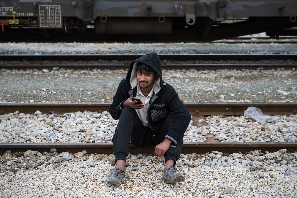 A man from Pakistan is sitting at the railway tracks in Idomeni train station. <br /> <br /> Thousands of refugees are stranded in Idomeni unable to cross the border. The facilities are stretched to the limit and the conditions are appalling.