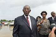"""5/30/15 Indianola,Civil rights icon and BB Kings good friend Charles Evers arrives for the funeral in Indianola Mississippi. Fans to see B. B Kings final home coming funeral procession outside the BB King Museum. A family member reaches out to touch the casket for one last time at the gravesite of Mr. King during the burial outside in the rain. The Thrill is gone, the casket holding the body of BB King arrives at the Bell Grove Missionary Baptist Church for his final homecoming. Blues legend B.B. King is is laid to rest in the shadow of the cotton gin at the B.B. King Museum and Interpretive Center. Mr King's final homecoming procession included a black horse WITH A saddle flanked with two of BB's famous """"Lucielle"""" guitars signed by Mr. King. Fans lined the streets to watch the procession and pay their respect to the King of the Blues. Photo ©Suzi Altman"""