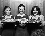 """Seafood Cook in Rosslare 07/05/1976.05/07/1976.7th May 1976.Pictured L-R, Siobhan Neeson, (15 years), 2nd prize, St. Louis Convent, Monaghan with her dish, """"Hot Peppered Cod"""", Yvonne Cooney, (15 years), Dominican Convent, Muckross Park, Dublin, the winner with her dish, """"Cod Pancake Casserole"""", and Judy Tormey, (16) St. Joseph's College, Summerhill, Athlone, Co. Westmeath, 3rd prize, with her dish """"Devilled Cod"""""""