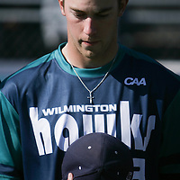 UNCW's Jared Gesell observes a moment of silence for Aaron Torian who was killed in Afghanistan Sunday February 16, 2014. Torian was a member of the UNCW grounds crew.  (Jason A. Frizzelle)