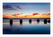 An intense pre-sunrise sky on a still spring morning, viewed from the Ross Jones Memorial Pool [Coogee, NSW, Australia]<br />