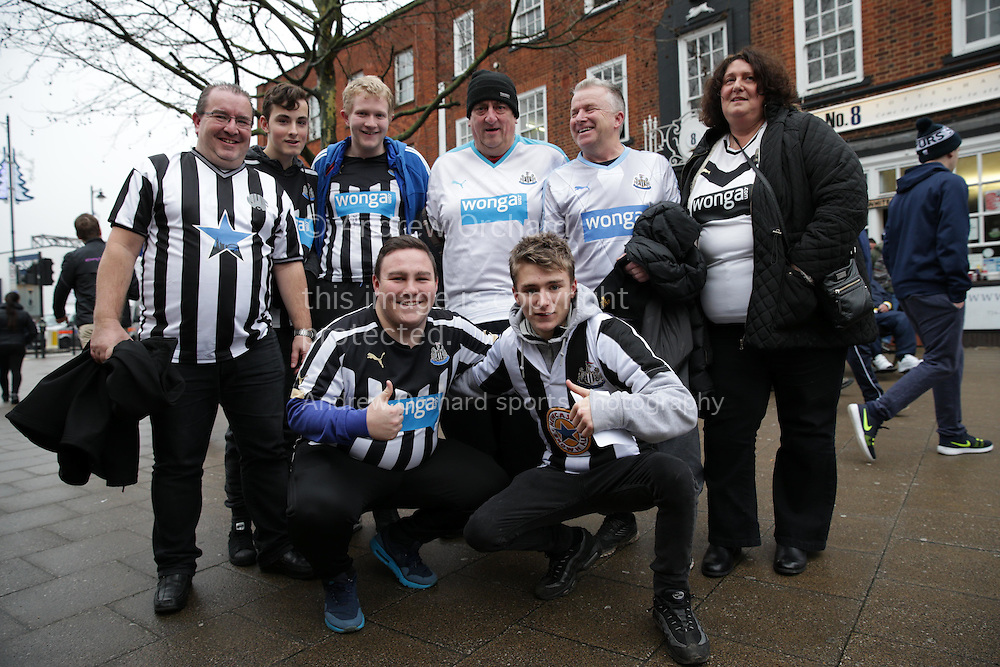 a Group of Newcastle United fans pose outside White Hart Lane Stadium before k/o. Barclays Premier league match, Tottenham Hotspur v Newcastle Utd at White Hart Lane in London on Sunday 13th December 2015.<br /> pic by John Patrick Fletcher, Andrew Orchard sports photography.