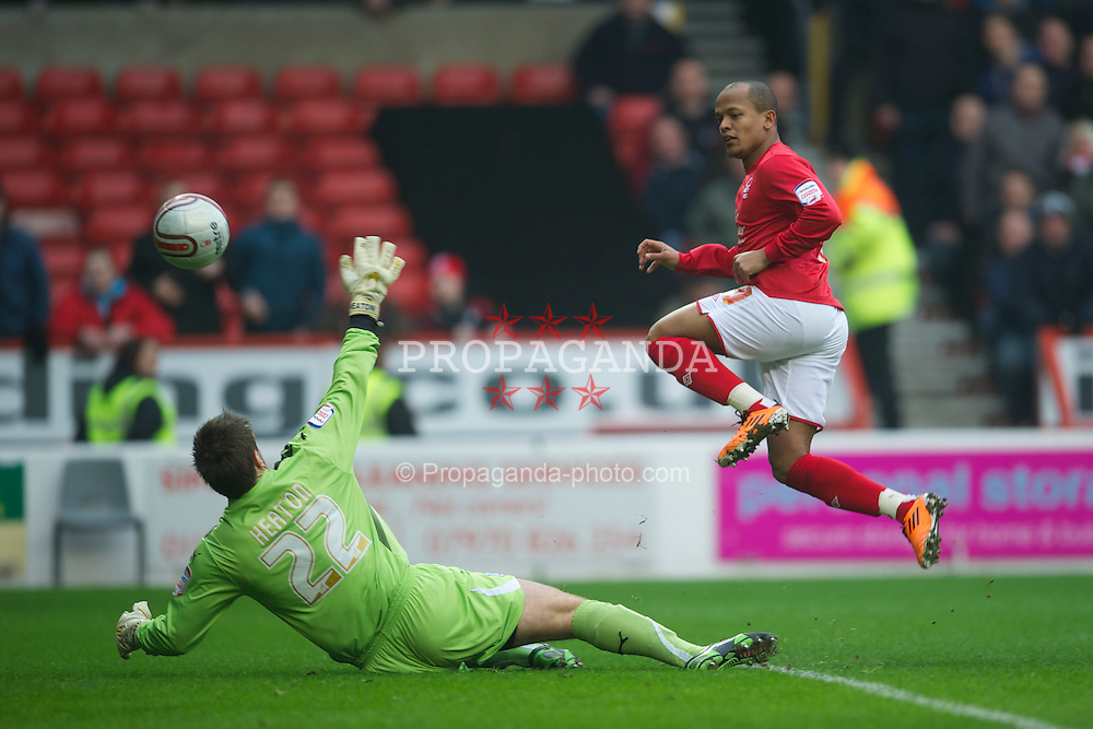 NOTTINGHAM, ENGLAND - Saturday, February 19, 2011: Cardiff City's goalkeeper Tom Heaton is beaten by Nottingham Forest's Robert Earnshaw but the goal was disallowed during the Football League Championship match at the City Ground. (Photo by David Rawcliffe/Propaganda)