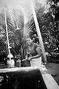 Renuka Sandamali och utedusch, byn Siriyagama, Sri Lanka.NOT FOR COMMERCIAL USE UNLESS PRIOR AGREED WITH PHOTOGRAPHER. (Contact Christina Sjogren at email address : cs@christinasjogren.com )
