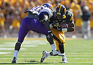 September 15 2012: Iowa Hawkeyes running back Damon Bullock (32) has he mouthguard knocked loose as he is hit by Northern Iowa Panthers defensive back Wilmot Wellington (20) during the first quarter of the NCAA football game between the Northern Iowa Panthers and the Iowa Hawkeyes at Kinnick Stadium in Iowa City, Iowa on Saturday September 15, 2012. Iowa defeated Northern Iowa 27-16.