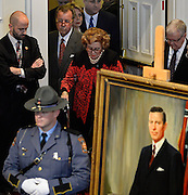Former Georgia First Lady Betty Sanders walks past a portrait of her husband, former Gov. Carl Sanders, during a memorial service at Second Ponce de Leon Baptist Church on Saturday, Nov. 22, 2014, in Atlanta. Six living Georgia governors attending the service included current Gov. Nathan Deal and former governors Jimmy Carter, Sonny Perdue, Roy Barnes, Zell Miller, and Joe Frank Harris. Photo by David Tulis