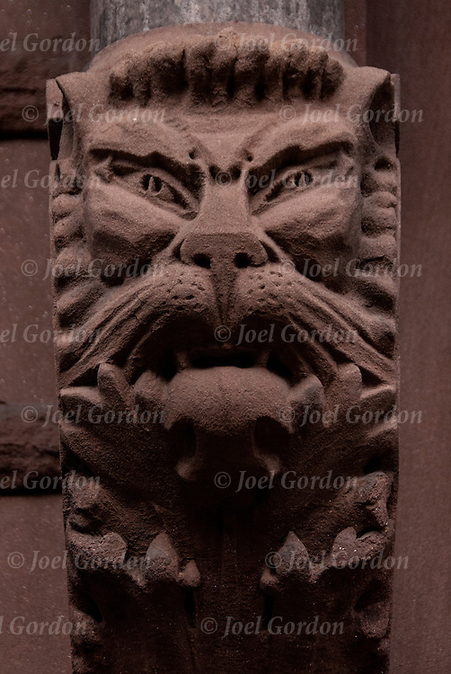 Architectural detail of lion face  in  stone on cornnice bracket of building, 19th century artistic ornamental use on building in Greenwich Village,  New York City.