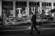A man gestures celebrating as vehicle with Donald Trump's propaganda tours around the city ahead of the presidential inauguration, Thursday, Jan. 19, 2017, in Washington DC.
