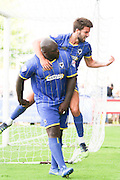 Winning Goal scored by Bayo Akinfenwa of AFC Wimbledon and celebrates with George Francomb of AFC Wimbledonduring the Sky Bet League 2 match between AFC Wimbledon and Notts County at the Cherry Red Records Stadium, Kingston, England on 19 September 2015. Photo by Stuart Butcher.