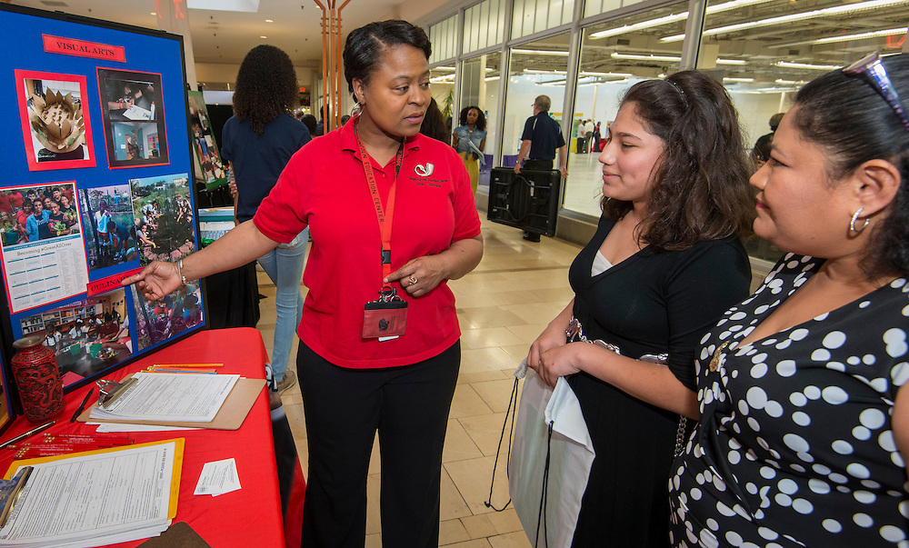 Gregory Lincoln Education Center magnet coordinator Cheryl Jones talks with a family during a School Choice Fair at Northwest Mall, April, 26, 2014.