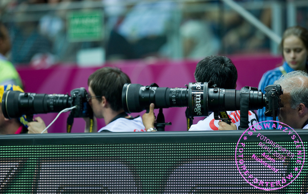 Photographers  with Nikon camera during the UEFA EURO 2012 Quarterfinal football match between Portugal and Czech Republic at National Stadium in Warsaw on June 21, 2012...Poland, Warsaw, June 21, 2012..Picture also available in RAW (NEF) or TIFF format on special request...For editorial use only. Any commercial or promotional use requires permission...Photo by © Adam Nurkiewicz / Mediasport