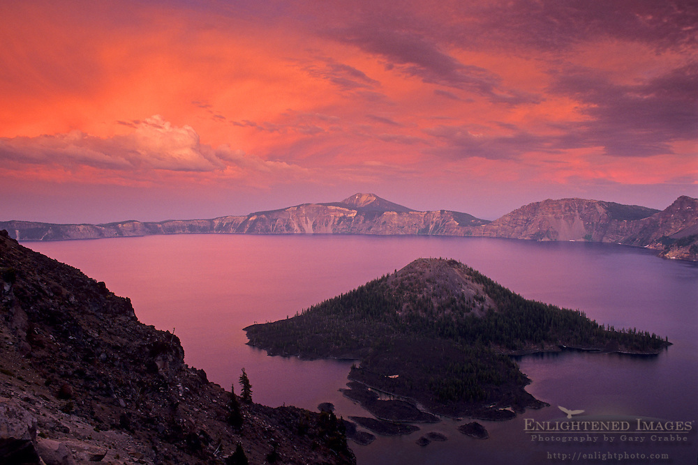 Alpenglow on storm clouds at sunset over Crater Lake, Crater Lake National Park, Oregon