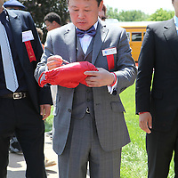 Boxer Myung-Woo Yuh signs autographs prior to being inducted into the Hall of Fame during the 2013 International Boxing Hall of Fame induction ceremony on Sunday, June 9, 2013 in Canastota, New York.  (AP Photo/Alex Menendez)